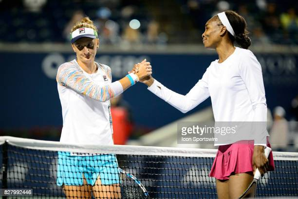 IrinaCamelia Begu of Romania and Venus Williams of the United States shake hands after their first round match of the 2017 Rogers Cup tennis...