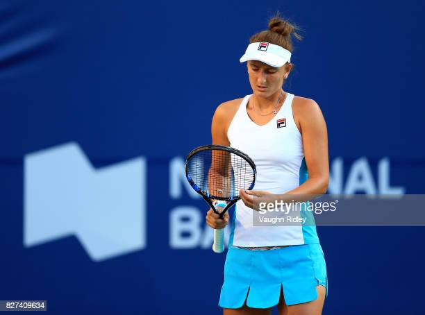 IrinaCamelia Begu of Romania checks her racket against Venus Williams of the United States during Day 3 of the Rogers Cup at Aviva Centre on August 7...