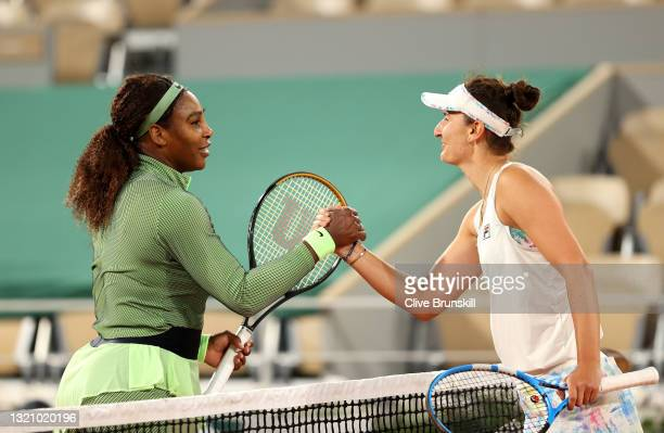 Irina-Camelia Begu of Romania congratulates Serena Williams of The United States on victory following their ladies singles first round match on day...