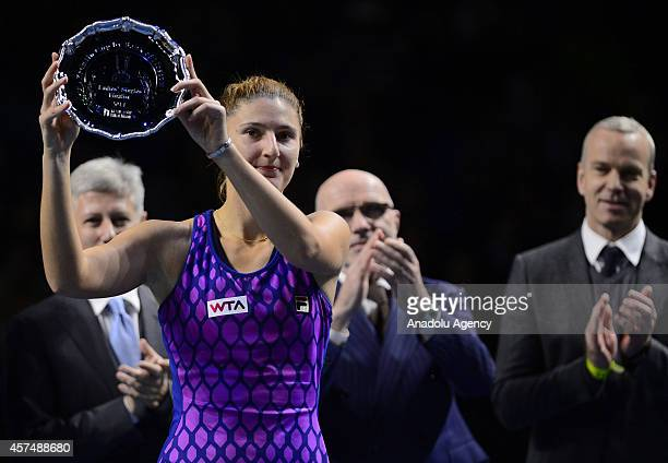 Irina-Camelia Begu of Romania defeated by her rival Anastasiya Pavlyucenkova of Russia holds the runner-up prize at the end of the Kremlin Cup 2014...