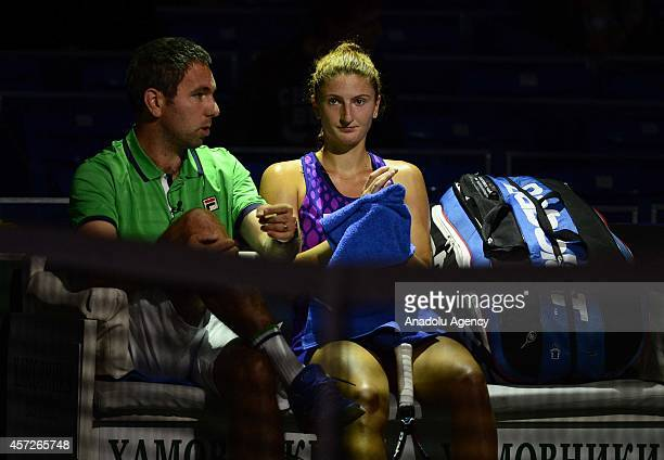 Irina-Camelia Begu of Romania has a break during her women singles tennis match on the 5th day of Kremlin Cup 2014 Tennis Tournament at the Olympic...