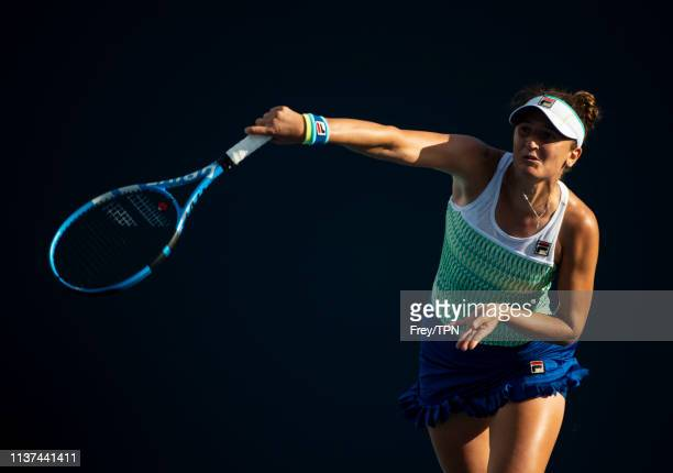 Irina-Camelia Begu of Romania hits a backhand against Bianca Adreescu of Canada in the second round of the women's singles at the Miami Open on March...