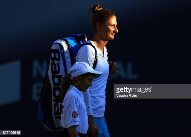 IrinaCamelia Begu of Romania makes her way onto the court prior to her match with Venus Williams of the United States during Day 3 of the Rogers Cup...