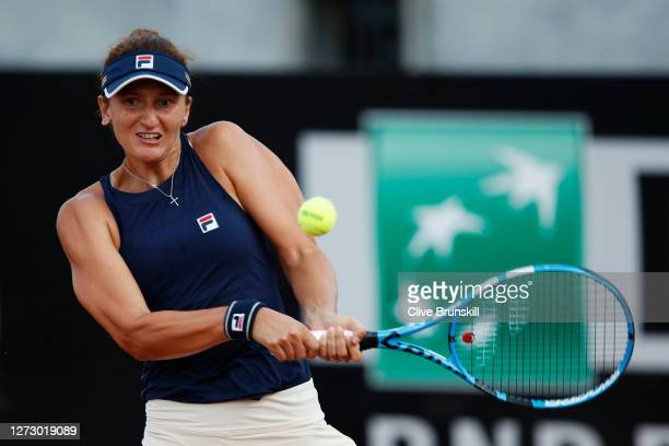 Irina-Camelia Begu of Romania plays a backhand in her round two match against Johanna Konta of Great Britain during day four of the Internazionali...