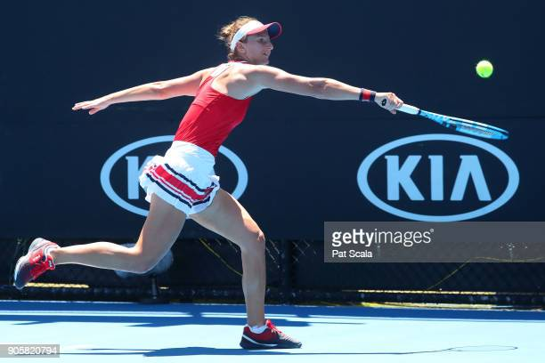 IrinaCamelia Begu of Romania plays a backhand in her second round match against Petra Martic of Croatia on day three of the 2018 Australian Open at...