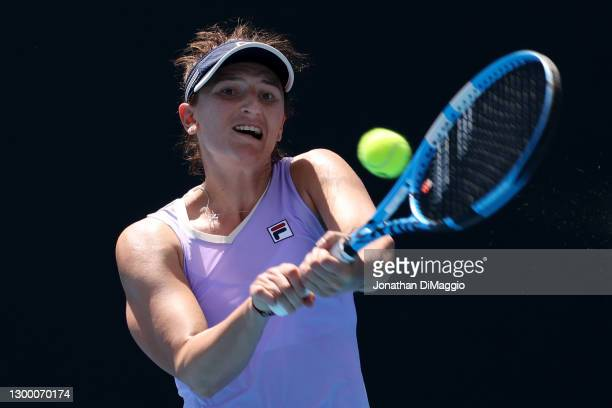 Irina-Camelia Begu of Romania plays a backhand in her singles match against Johanna Konta of Great Britian during day four of the WTA 500 Gippsland...