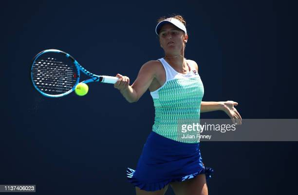 Irina-Camelia Begu of Romania plays a forehand against Bianca Andreescu of Canada during day four of the Miami Open tennis on March 21, 2019 in Miami...