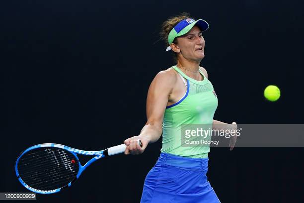 Irina-Camelia Begu of Romania plays a forehand during her Women's Singles first round match against Kiki Bertens of the Netherlands on day two of the...