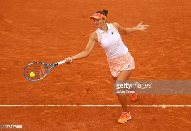 Irina-Camelia Begu of Romania plays a forehand during her Women's Singles second round match against Simona Halep of Romania on day four of the 2020...