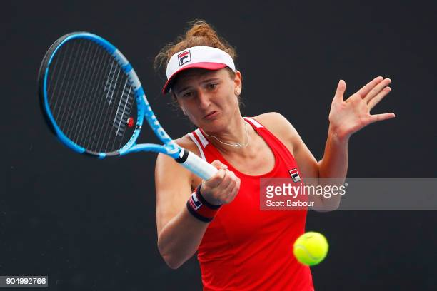 IrinaCamelia Begu of Romania plays a forehand in her first round match against Ekaterina Makarova of Russia on day one of the 2018 Australian Open at...