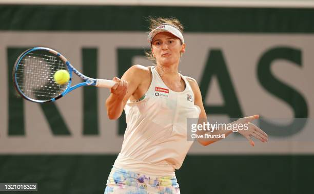 Irina-Camelia Begu of Romania plays a forehand in their ladies singles first round match against Serena Williams of The United States on day two of...