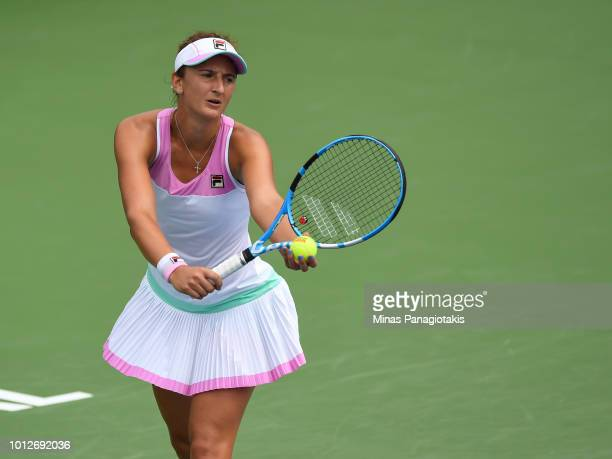 Irina-Camelia Begu of Romania prepares to serve against Ashleigh Barty of Australia during day two of the Rogers Cup at IGA Stadium on August 7, 2018...
