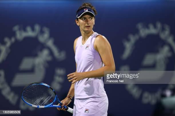 Irina-Camelia Begu of Romania reacts in her singles match against Garbine Muguruza of Spain during Day Two of the Dubai Duty Free Tennis at Dubai...
