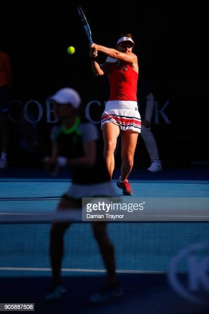 IrinaCamelia Begu of Romania returns serve in her first round doubles match with Monica Niculescu of Romania against Mirjana LucicBaroni of Croatia...