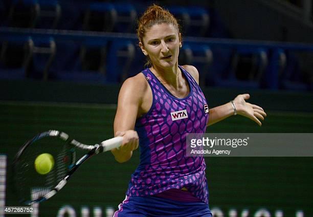Irina-Camelia Begu of Romania returns the ball against Ekaterina Makarova of Russia during the women singles tennis match on the 5th day of Kremlin...