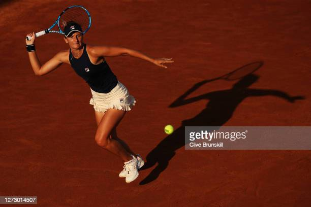 Irina-Camelia Begu of Romania runs to play a forehand in her round two match against Johanna Konta of Great Britain during day four of the...