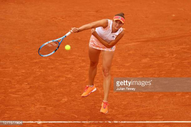 Irina-Camelia Begu of Romania serves during her Women's Singles second round match against Simona Halep of Romania on day four of the 2020 French...