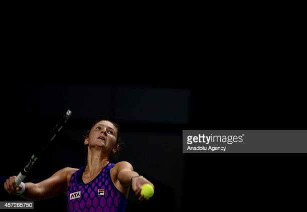 Irina-Camelia Begu of Romania serves the ball during her women singles tennis match on the 5th day of Kremlin Cup 2014 Tennis Tournament at the...