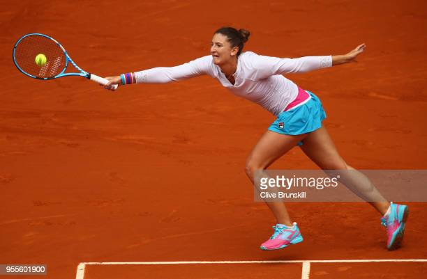Irina-Camelia Begu of Romania stretches to play a forehand against Maria Sharapova of Russia in their second round match during day three of the...