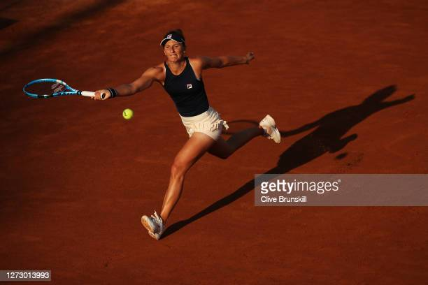 Irina-Camelia Begu of Romania stretches to play a forehand in her round two match against Johanna Konta of Great Britain during day four of the...