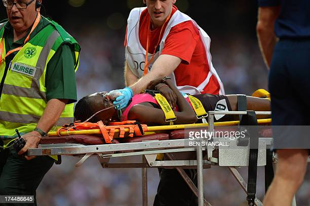 Irine Chebet Cheptai of Kenya receives medical attention after the women's 3000 metres event during the London Anniversary Games International...