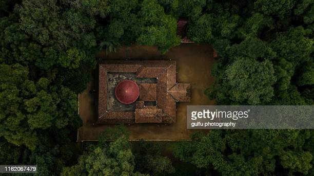 iringole kavu is a famous hindu in forest temple dedicated to goddess durga - kerala stock pictures, royalty-free photos & images