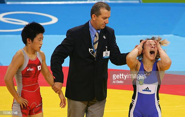 Irini Merleni of the Ukraine celebrates after beating Chiharu Icho of Japan in the women's Freestyle wrestling 48 kg gold medal match on August 23,...