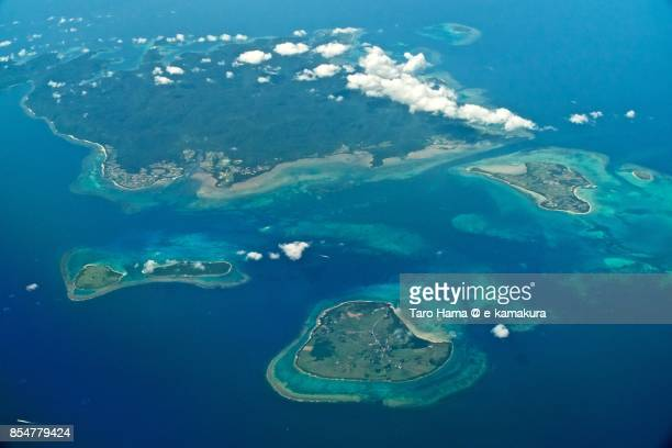 iriomote, kohama, kuro, taketomi and aragusuku islands in okinawa prefecture daytime aerial view from airplane - okinawa prefecture stock pictures, royalty-free photos & images
