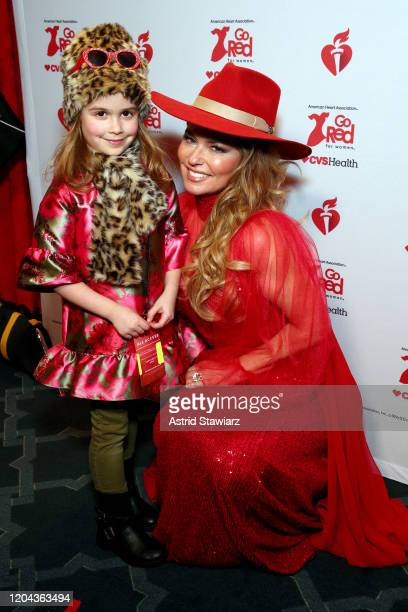 Iris Achilleas and Shania Twain attend the American Heart Association's Go Red for Women Red Dress Collection 2020 at Hammerstein Ballroom on...