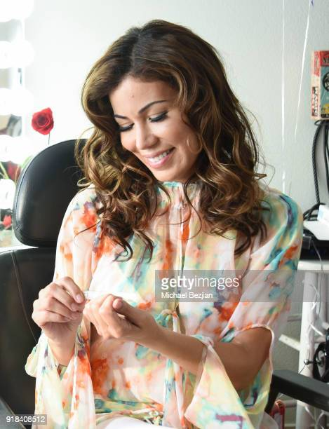 Iris Almario using Bling Bling Nail Care at The Artists Project Giveback Day on February 14 2018 in Los Angeles California