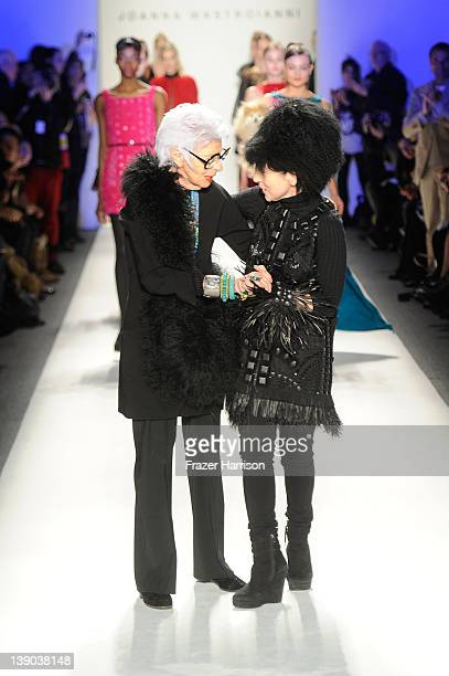 Iris Apfel and Designer Joanna Mastroianni walk the runway at the Joanna Mastroianni Fall 2012 fashion show during MercedesBenz Fashion Week at The...