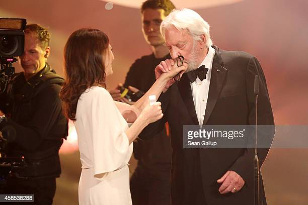 Iris Berben and Donald Sutherland are seen on stage at the GQ Men Of The Year Award 2014 at Komische Oper on November 6 2014 in Berlin Germany
