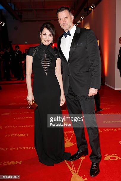 Iris Berben and Heiko Kiesow attend the Goldene Kamera 2014 at Tempelhof Airport on February 01 2014 in Berlin Germany