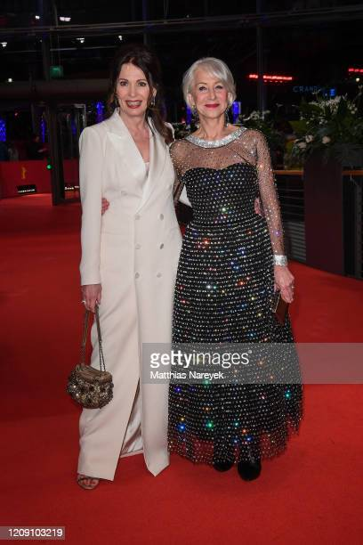 Iris Berben and Helen Mirren arrive for the Homage Helen Mirren Honorary Golden Bear award ceremony during the 70th Berlinale International Film...