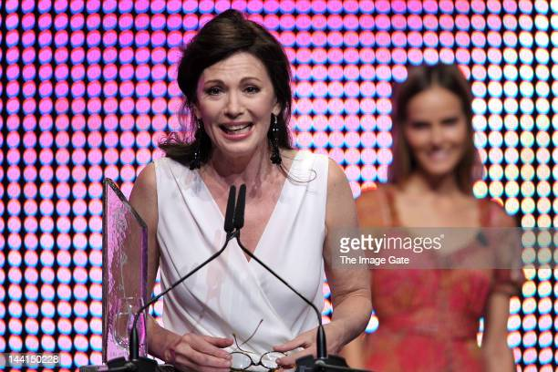 Iris Berben delivers a speech as she receives the Lifetime Rose Awards during the Rose d'Or television festival award ceremony held at the KKL on May...