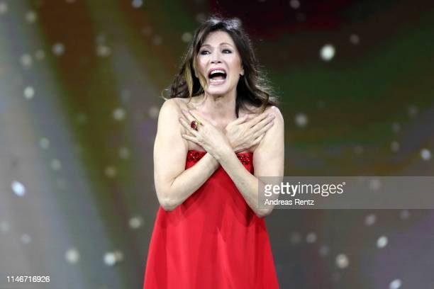 Iris Berben, former President of the German Film Academy, reacts on stage during the Lola - German Film Award show at Palais am Funkturm on May 03,...