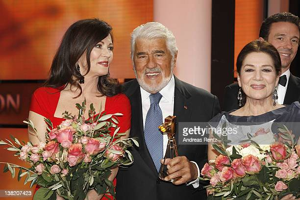 Iris Berben Mario Adorf Hannelore Elsner and Oliver Berben pose for a final picture at the 47th Golden Camera Awards at the Axel Springer Haus on...