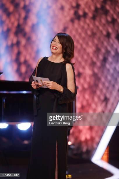 Iris Berben President of the Deutsche Filmakademie congratulating Peter Simonischek for winning Best Actor at the Lola German Film Award show at...