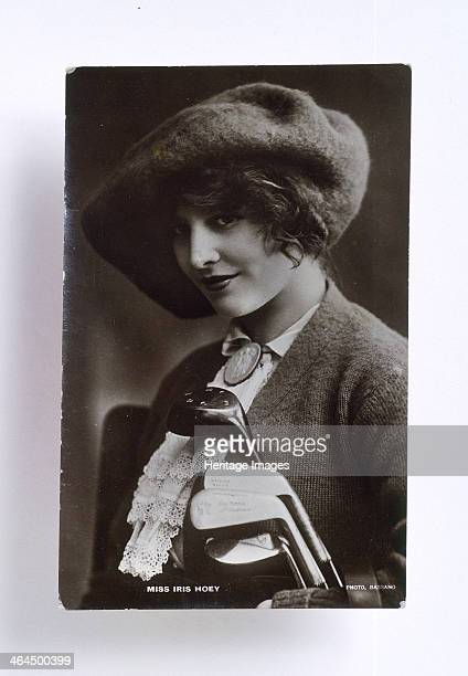 Iris Hoey, English actress , c1920, with a set of golf clubs.