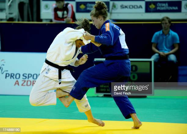 Iris Iwema of Holland catches fellow Dutch woman Elea De Gans with a foot sweep to secure the gold medal during their u63kgs final contest at the...