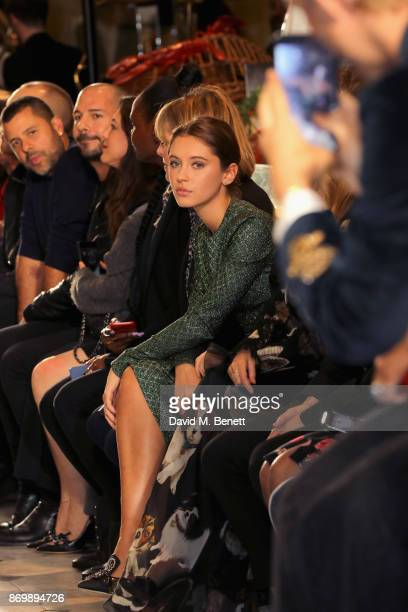 Iris Law attends the Dolce Gabbana Italian Christmas catwalk show at Harrods on November 2 2017 in London England