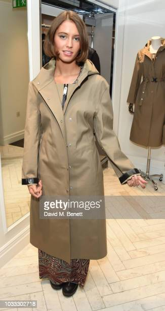 Iris Law attends the launch of the Nick Knight x Alyx Mackintosh limited edition coat during London Fashion Week September 2018 at the Mackintosh...