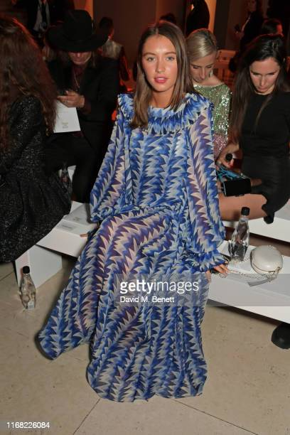 Iris Law sits in the front row at Fashion For Relief London 2019 at The British Museum on September 14 2019 in London England