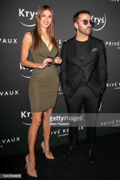 Iris Mittenaere and actor Jeremy Piven attend the Prive Revaux Eyewear Photocall at Cafe de l'Homme as part of the Paris Fashion Week Womenswear...