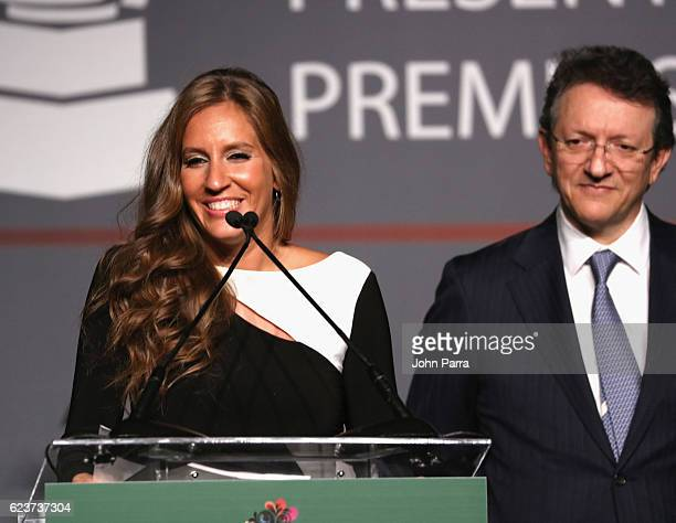 Iris Oliveros and President of the Latin Recording Academy Gabriel Abaroa speak onstage during the 2016 Latin Recording Academy Special Awards during...