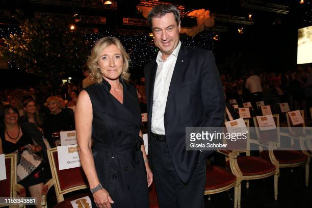 Iris Ostermaier and Markus Soeder Prime Minister of Bavaria during the Bavaria Film Reception One Hundred Years in Motion on the occasion of the...