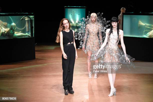 Iris Van Herpen acknowledges the audience at the end of the Iris Van HerpenHaute Couture Fall/Winter 20172018 show as part of Haute Couture Paris...