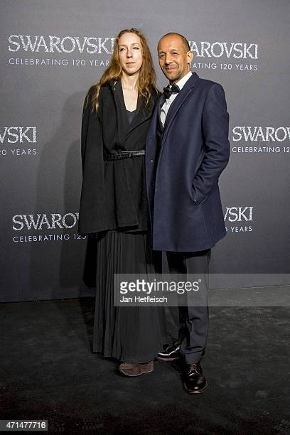 Iris Van Herpen and Bradly Dunn Klerks pose for a picture on the 'black' carpet of the grand reopening of the Swarovski Crystal Worlds on April 28...