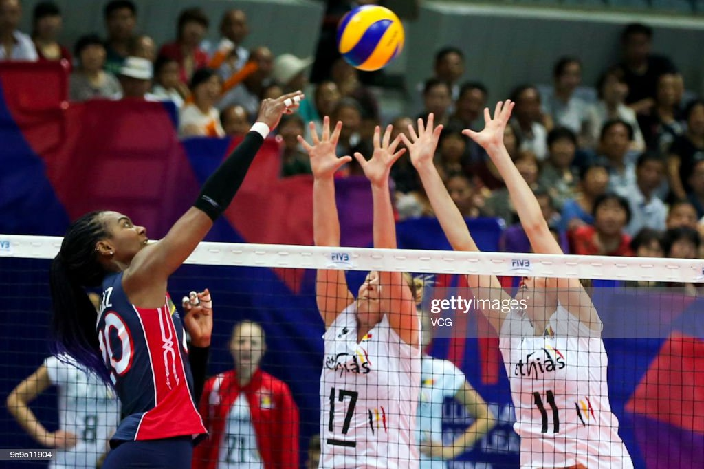 Iris Vandewiele #11 and Ilka Van De Vijver #17 of Belgium defend against Brayelin Elizabeth Martinez #20 of the Dominican Republic during the FIVB Volleyball Nations League 2018 at Beilun Gymnasium on May 17, 2018 in Ningbo, China.