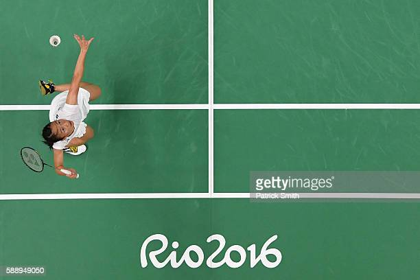 Iris Wang of the United States returns a shot to Telma Santos of Portugal during the Women's Badminton Singles Group Play Stage - Group E on Day 7 of...